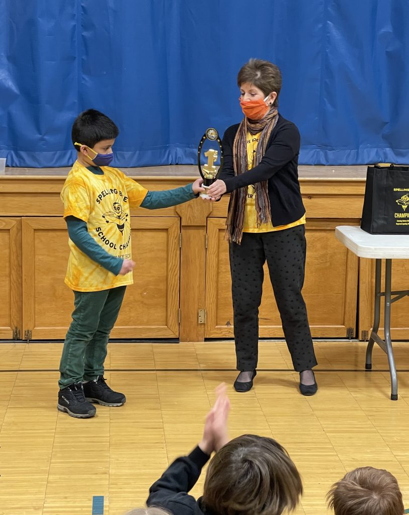 Joseph receives trophy from Sheila 813x1024 - Corning Rotary Announces Spelling Bee Winners